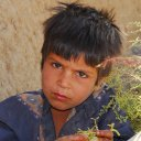 I am regarded with suspicion by this boy, whom I ran into in northern Afghanistan
