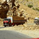 Lumber that was likely harvested in the deep valleys of Northern Afghanistan's Hindukush Mountains being trucked into Kabul