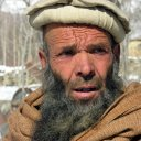 Deep lines have etched this man's face, testimony to the destruction of two decades of war he has suffered under