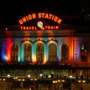 Union Station lit up in bright colors during a frosty December night
