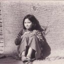 Girl sitting on streets in Thamel, Kathmandu Nepal