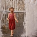 Girl playing in water, Budapest Hungary