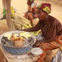 Woman-selling-dried-roasted-corn