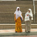 Sights like this of two muslim Malay women in their traditional head scarves, are common of women all over Malaysia