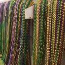 Hanging beads on Float Mardi Gras