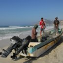 These fishermen mend their nets after a hard day of fishing off the coast of southern Oman in the Indian Ocean