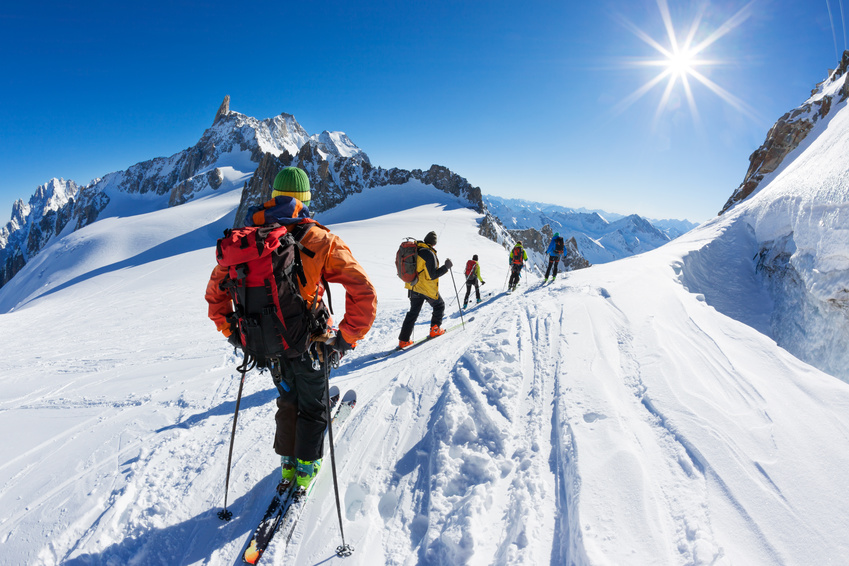 A group of skiers start the descent of Valle Blanche, Mont Blanc Massif, Chamonix, France.