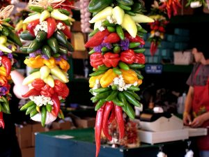 Hanging bunches of peppers at Pike's Market in Seattle