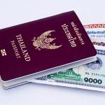 Thai passport with Lao money.