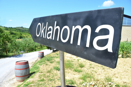 Oklahoma arrow and wine barrels along rural road