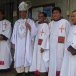 Fr._Jay_Saniel__3rd_from_left__with_Kidapawan_Bishop_Romulo_De_la_Cruz_after_the_installation_mass_at_the_Holy_Family_Parish_in_Bulakanon__Makilala