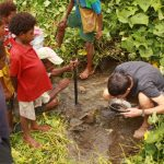 Trying hand at gold panning near Misima