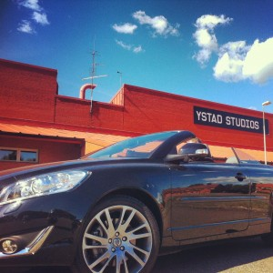 Our C70 Volvo parked in front of Ystad Studios