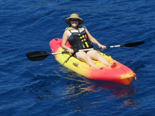 Debbie kayaking from the watersports platform