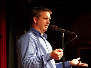 Onstage at the Moth. Photo credit: Jason Falchook