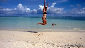 Author jumping for joy in the midst of another of Palau's spectacular postcard views!