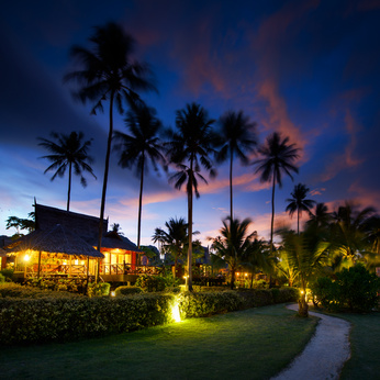 Bungalows at sunset in thailand paradise