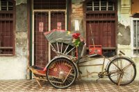 The Amazingly Industrious Trishaw Driver from the Sultan's Kraton