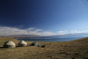 An oasis in a remote area - Yurts along the shoreline of Song-Kul Lake