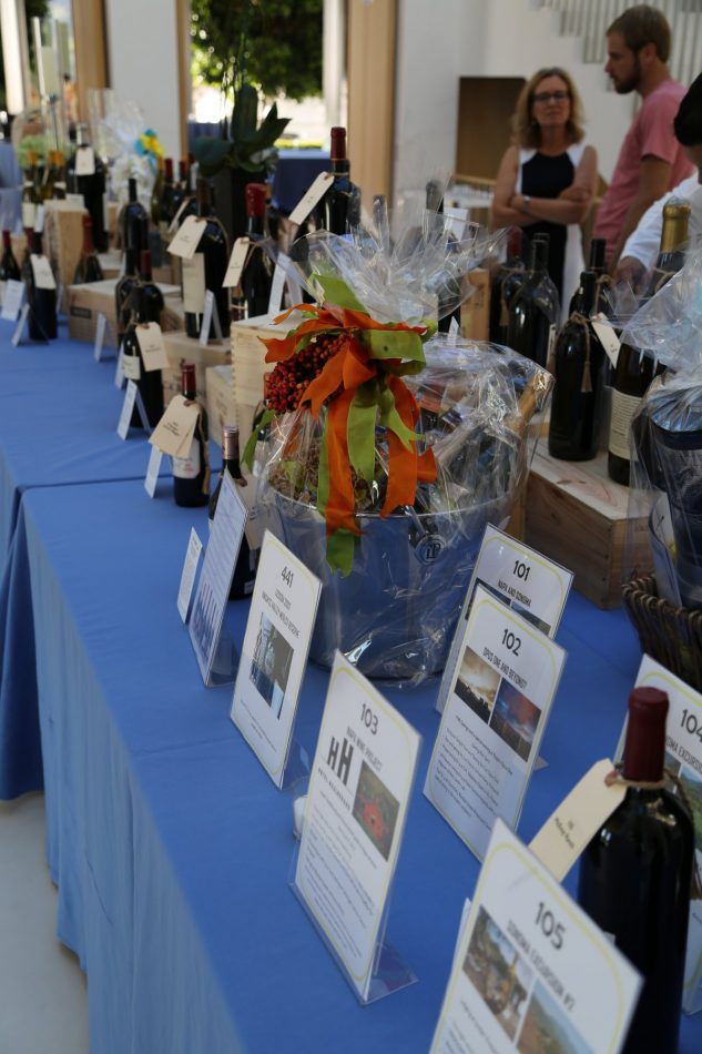 The wine auction table is packed with goodies!
