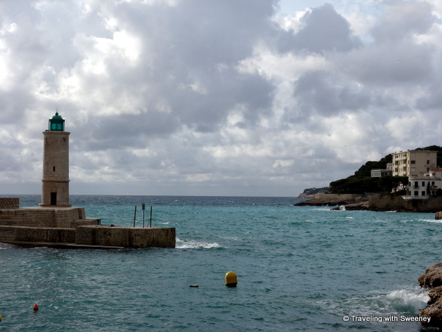 Lighthouse at the tip of the Quai des Moulins in the port of Cassis