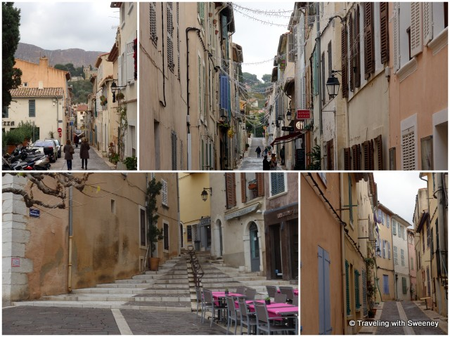 Narrow streets of Cassis lined with colorful houses, shops, and restaurants