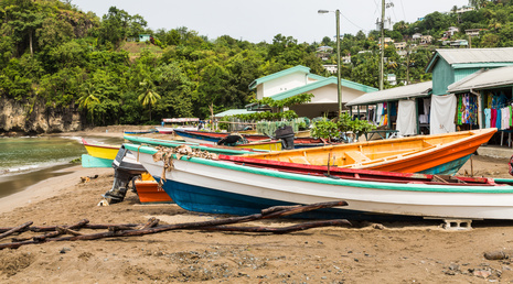 Colorful Fishing Boats on Beach Behind old Houses