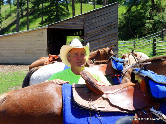 Ray Rugg of Rugg's Outfitting saddling up our horses