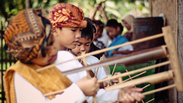 Children practice the angklung