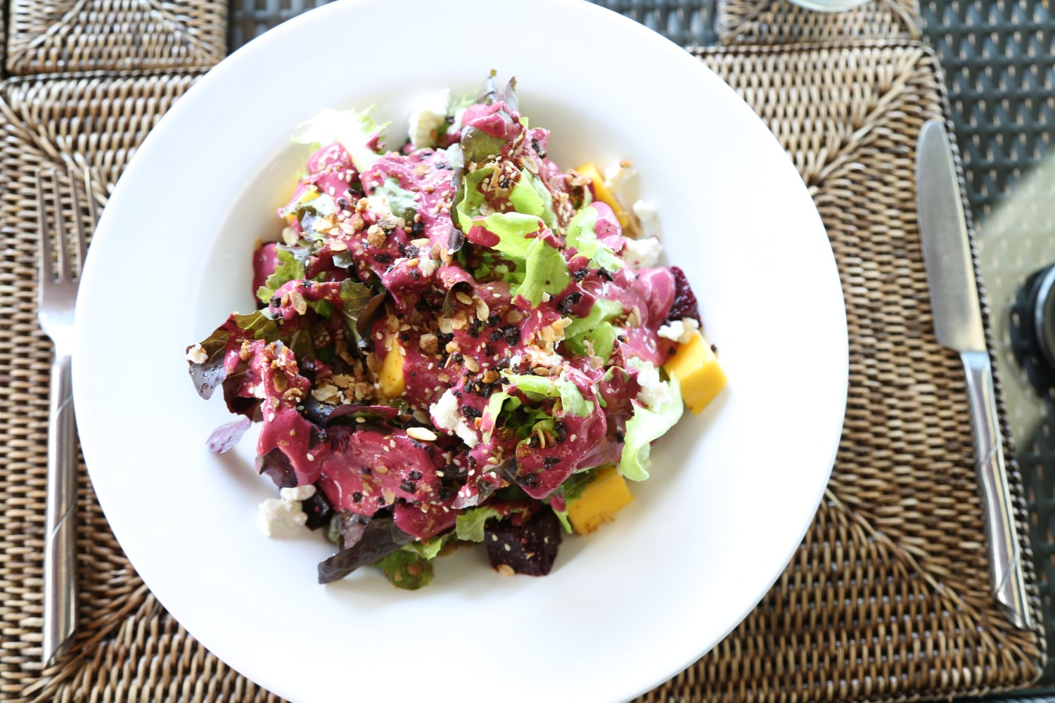 Delicious beetroot, mango and lettuce salad, poolside