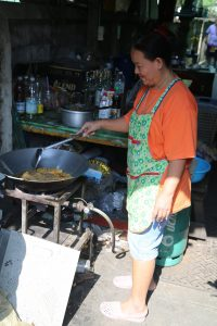 Happily cooking in a narrow alleyway in Klong Toey