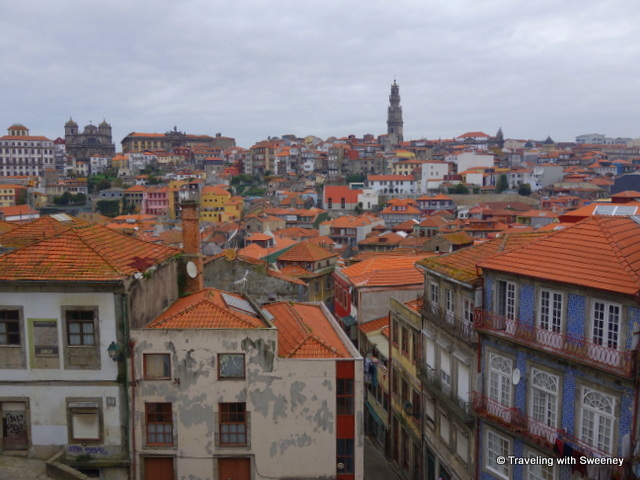 Over the rooftops of the colorful buildings of Porto, the tower of Clérigos Church is visible from many points in the city and surrounding area