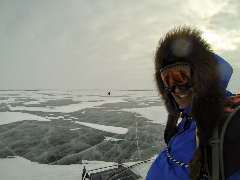 Bruno and I snowmobiling across the frozen Mackenzie River