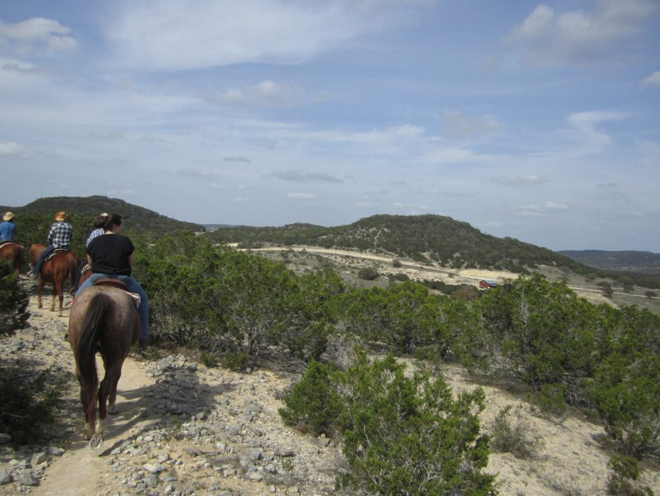 Horse riding around Silver Spur Ranch Bandera, TX