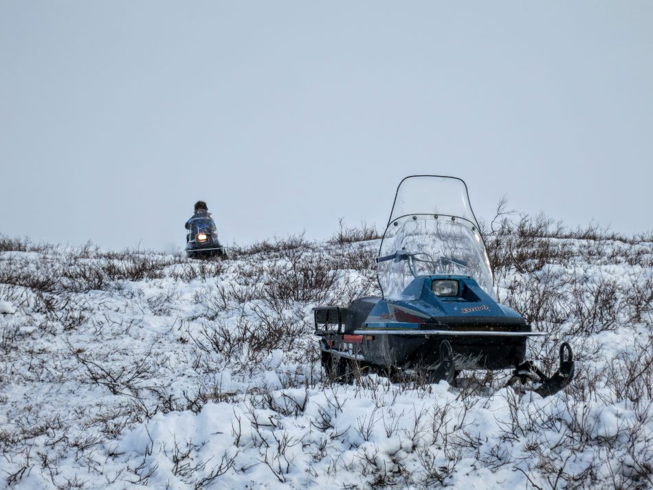 Bruno driving down his snowmobile