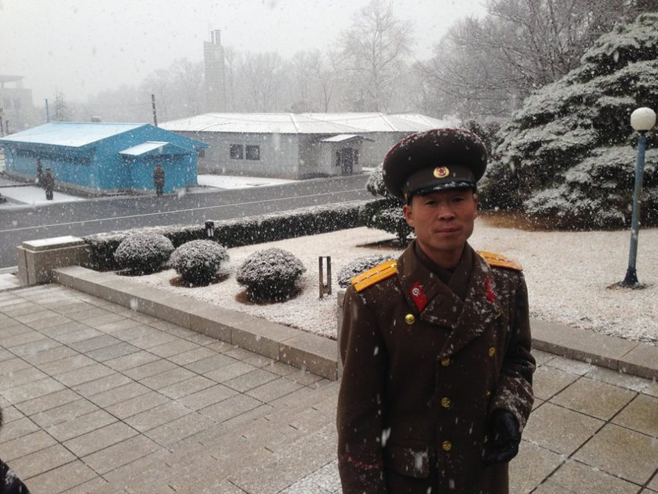 A North Korean soldier stares into the camera
