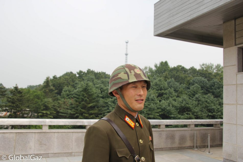A North Korean soldier smiles for the camera