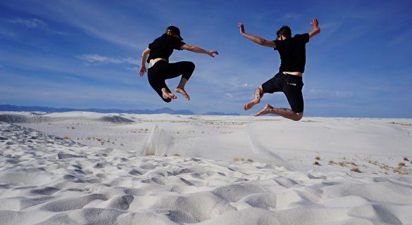 allison-and-eric-jump-dunes