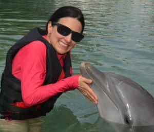 The Educational Tourist with dolphin, Swim with Dolphins