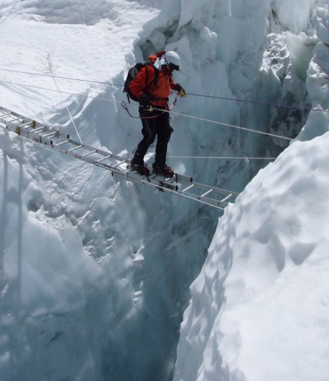 Tori Crossing Ladder in Khumbu Icefall