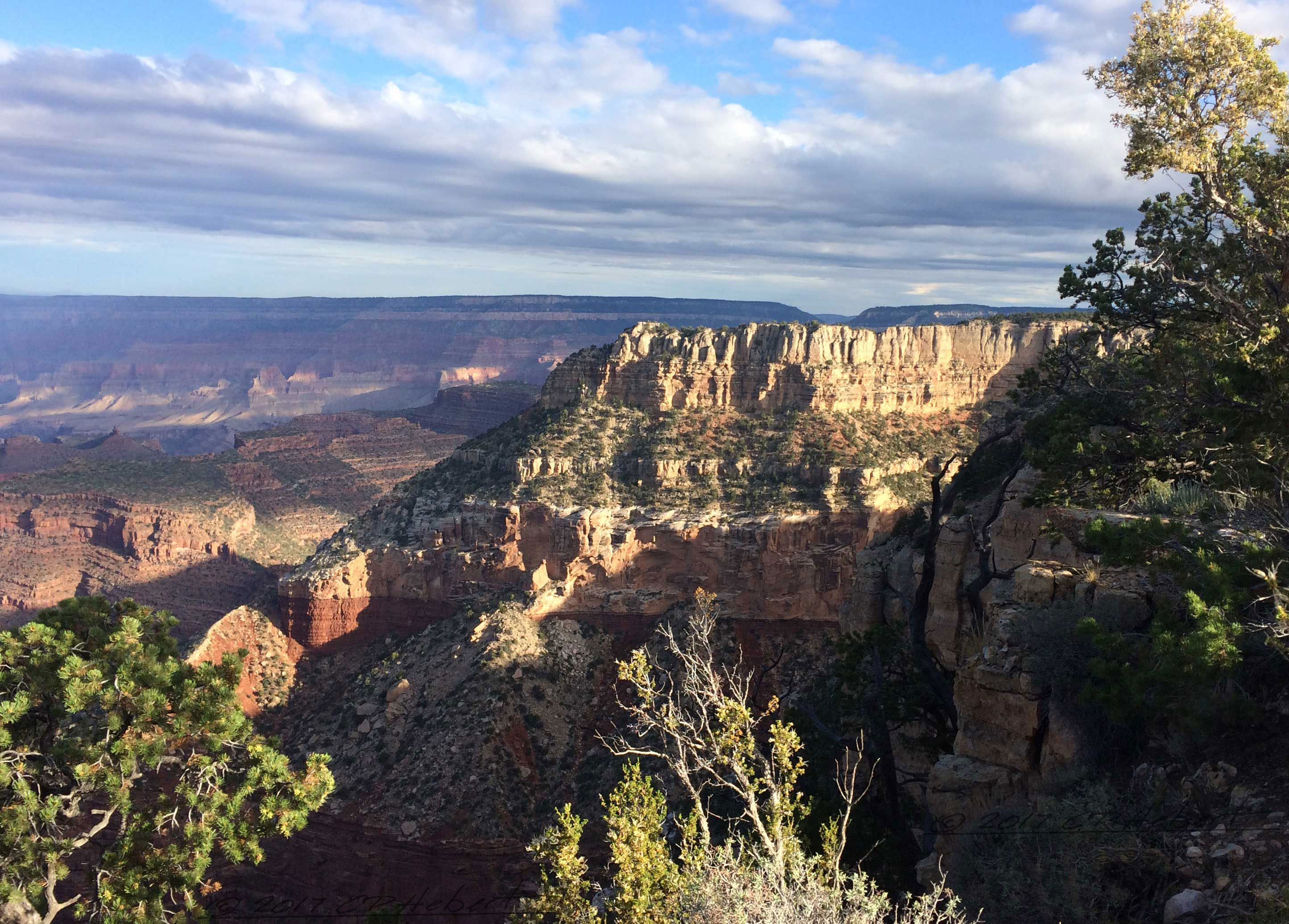 Patience pays off as we wait for the clouds to clear and allow some sunshine to paint the canyon walls.