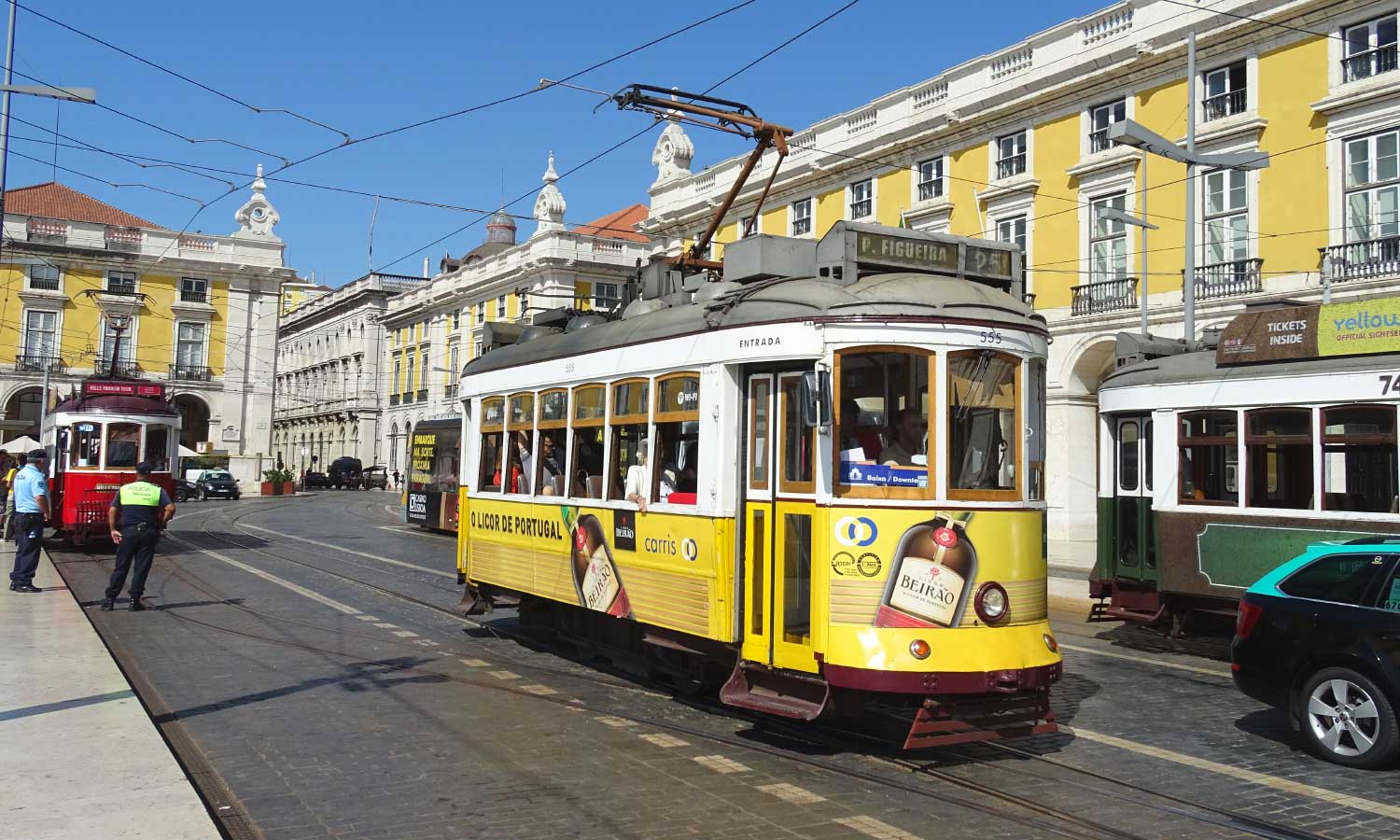 Getting around in Lisbon - Shows a tram on the streets of Baixa