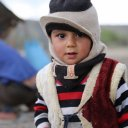 Nomadic boy - only way to stop him from crying was to take his photo ... again and again