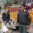 Happy fruit vendor and customer