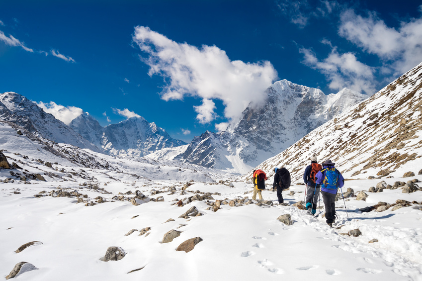 Trekkers and Sherpas going back from Everest Base Camp