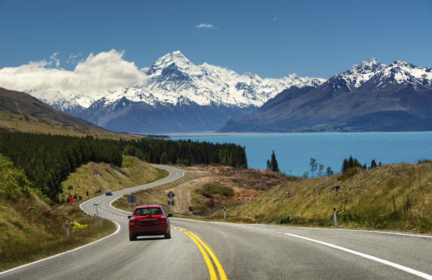 Red car on the road to Mt.Cook,New Zealand