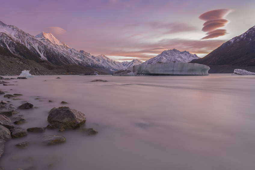 NEW ZEALAND 18TH APRIL 2014 ; Lenticular clouds pass over Mt Cook South Islands New Zealand during a beautiful morning