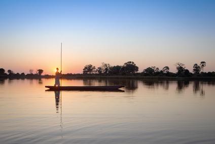 Mokoro poler in the Okavango Delta.