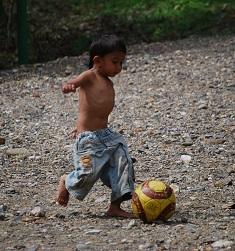 Our jungle guide Johan's son kicking a slightly deflated ball.