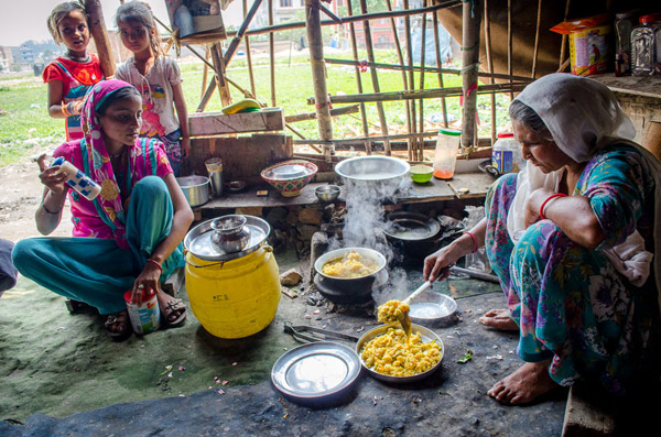 A mother dishing up rice for lunch